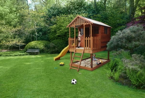cedar playhouse with slide by shed quarters